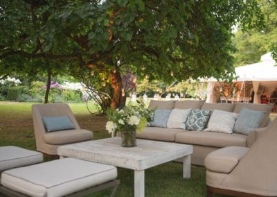 Fay Campbell Events Private Garden Party sofas and cushions under tree outside